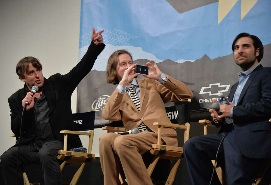 "AUSTIN, TX - MARCH 10:  (L-R) Director Richard Linklater, director Wes Anderson and actor Jason Schwartzman speaks at the discussion for the film ""The Grand Budapest Hotel"" during hte 2014 SXSW Music, Film + Interactive Festival at Paramount Theatre on March 10, 2014 in Austin, Texas. Photo: Michael Buckner, Getty Images For SXSW / 2014 Getty Images"