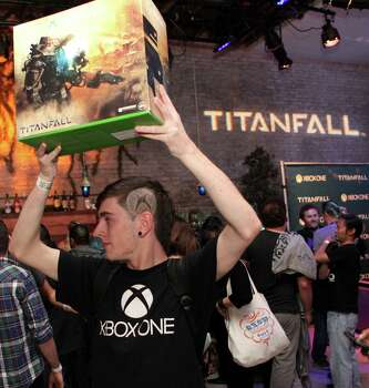 "IMAGE DISTRIBUTED FOR MICROSOFT - A fan celebrates the launch of ""Titanfall"" on Xbox One at SXSW on Monday, March 10, 2014, in Austin, Texas. (Photo by Hal Horowitz/Invision for Microsoft/AP Images) Photo: Hal Horowitz, Associated Press / Invision"