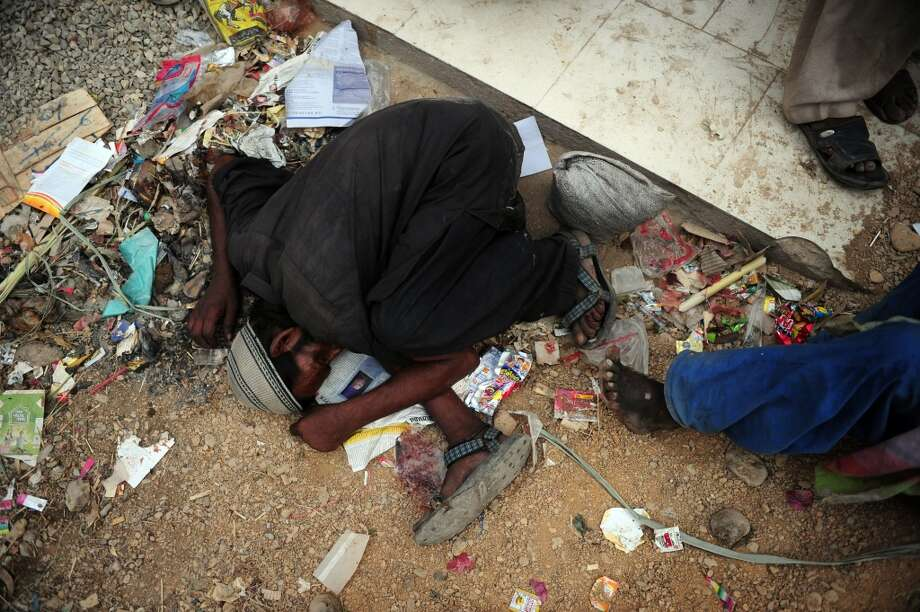 A Pakistani drug user sleeps on the street after injecting heroin on a street in Karachi on June 25, 2012. Pakistan has more than four million drug addicts in a population of nearly 180 million, according to figures compiled by the Anti-Narcotics Force (ANF),  which is responsible for investigating and prosecuting drug offences. AFP PHOTO / Asif HASSANASIF HASSAN/AFP/GettyImages Photo: ASIF HASSAN, AFP/Getty Images
