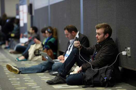 An attendee talks on a smartphone in the halls of the Austin Convention Center during the South By Southwest (SXSW) Interactive Festival in Austin, Texas, U.S., on Monday, March 10, 2014. The SXSW conferences and festivals converge original music, independent films, and emerging technologies while fostering creative and professional growth. Photographer: David Paul Morris/Bloomberg Photo: David Paul Morris, Bloomberg / © 2014 Bloomberg Finance LP