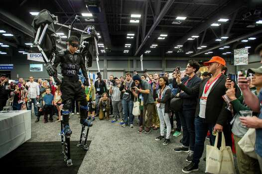 An exhibitor from Skeletonics Inc. demonstrates a robotic skeleton suit for attendees at the South By Southwest (SXSW) Interactive Festival in Austin, Texas, U.S., on Monday, March 10, 2014. The SXSW conferences and festivals converge original music, independent films, and emerging technologies while fostering creative and professional growth. Photographer: David Paul Morris/Bloomberg Photo: David Paul Morris, Bloomberg / © 2014 Bloomberg Finance LP