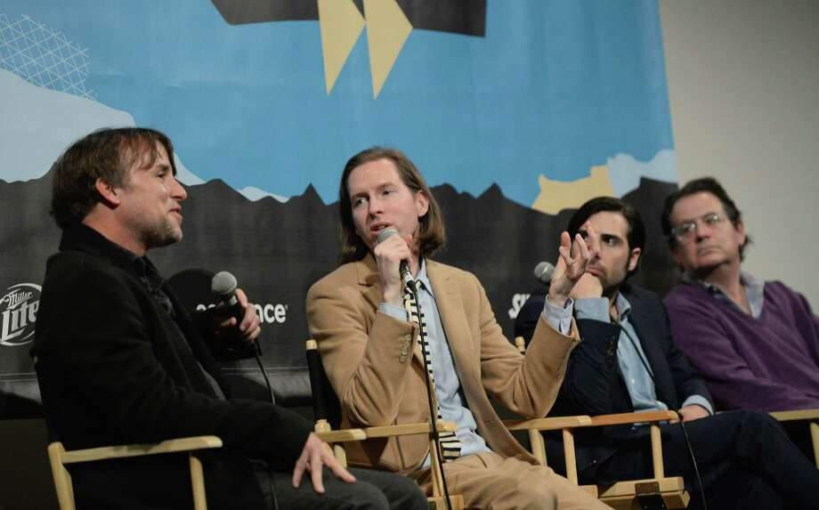"AUSTIN, TX - MARCH 10:  (L-R) Director Richard Linklater, director Wes Anderson, actor Jason Schwartzman and music supervisor Randall Poster speak at the discussion for the film ""The Grand Budapest Hotel"" during hte 2014 SXSW Music, Film + Interactive Festival at Paramount Theatre on March 10, 2014 in Austin, Texas. Photo: Michael Buckner, Getty Images For SXSW / 2014 Getty Images"