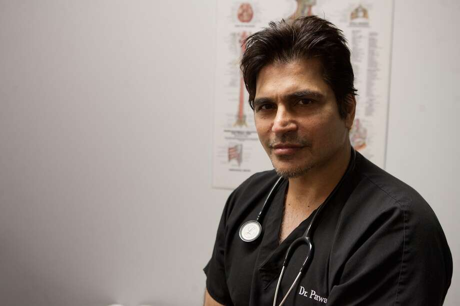Pavan Grover, MD, spinal surgeon and movie impresario, in his Southwest Houston office...  Photo By R. Clayton McKee Photo: R. Clayton McKee, Freelance / © R. Clayton McKee