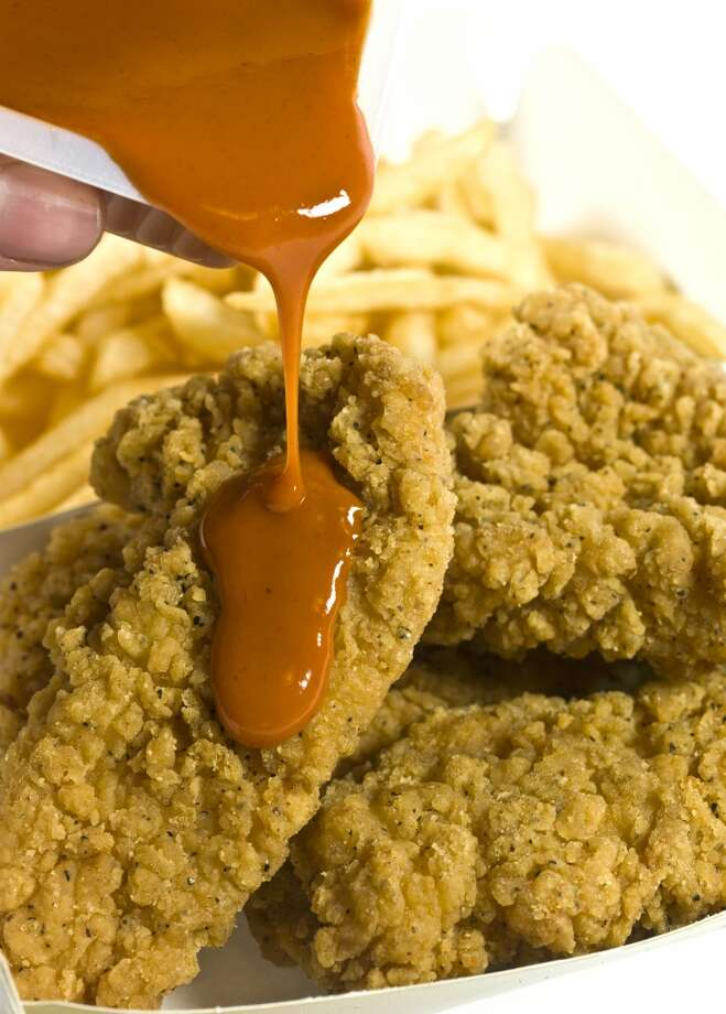 Naked chickenA man  who got stuck breaking into a Mr. Beef restaurant in Chicagofound it easier to get in after taking his clothes off. Once he made it past the window's bars, he microwaved a chicken tender snack before police caught him. The break-in was caught on video. Photo: Juanmonino, Getty Images