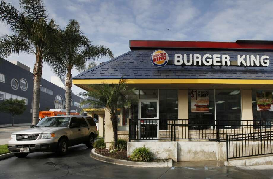 BK 'bikini brawler'A woman in a bikini was arrested after she was caught on camera jumping on top of a Burger King counter and throwing a donation jar at employees, and pulling the hair of one employee. The woman said she thought the restaurant was preparing her food too slowly. Photo: Nick Ut, Associated Press