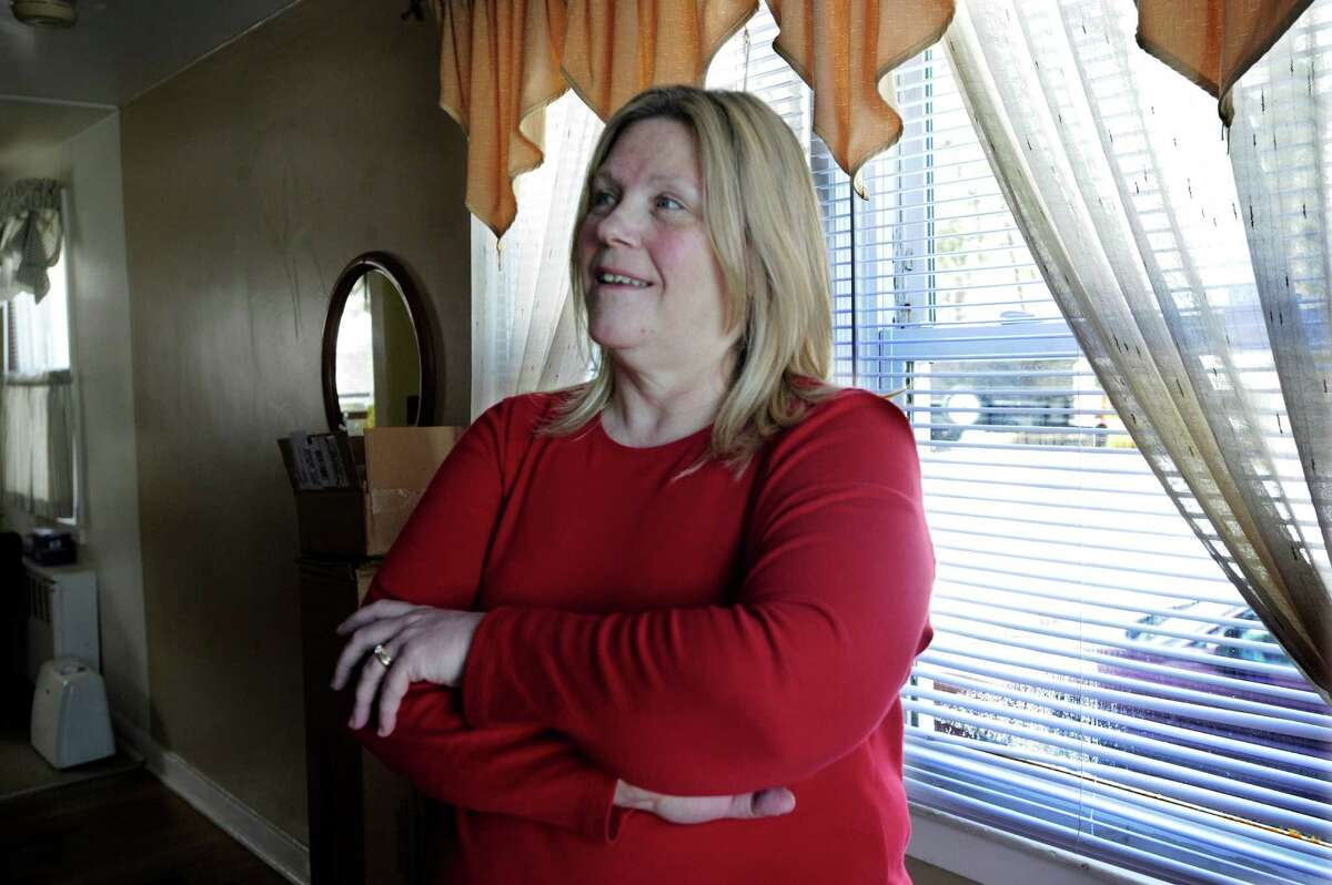 Linda Duncan, 51, talks about the energy upgrades done at her home on Mill Ridge Road in Danbury, Conn., Tuesday, March 11, 2014.