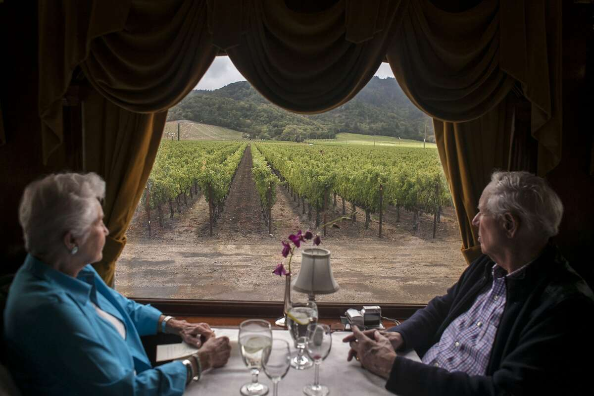 Bob Bozzani and Tarla Thiel look out at the vineyards during a ride on the Napa Valley Wine Train to Castello di Amorosa in Calistoga, on September 30th 2013.