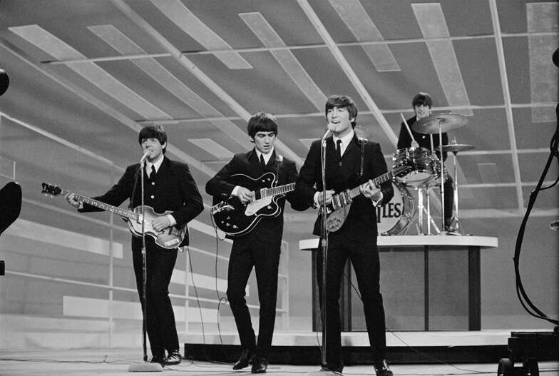 NEW YORK - FEBRUARY 9: The Beatles perform during their first appearance on THE ED SULLIVAN SHOW, February 9, 1964.  Paul McCartney, George Harrison, John Lennon and Ringo Starr are shown.  (Photo by CBS via Getty Images) *** Local Caption *** Paul McCartney;George Harrison;Ringo Starr;John Lennon