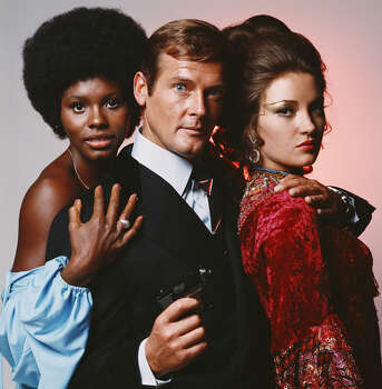 """Live and Let Die"" – Roger Moore debuts as suave secret agent James Bond, who's sent to the United States to go after a master criminal scheming to take over the country by turning the populace into heroin junkies. Paul McCartney provides the Oscar-nominated title tune. Available Now! Photo: Terry O'Neill, Getty Images / 2007 Getty Images"