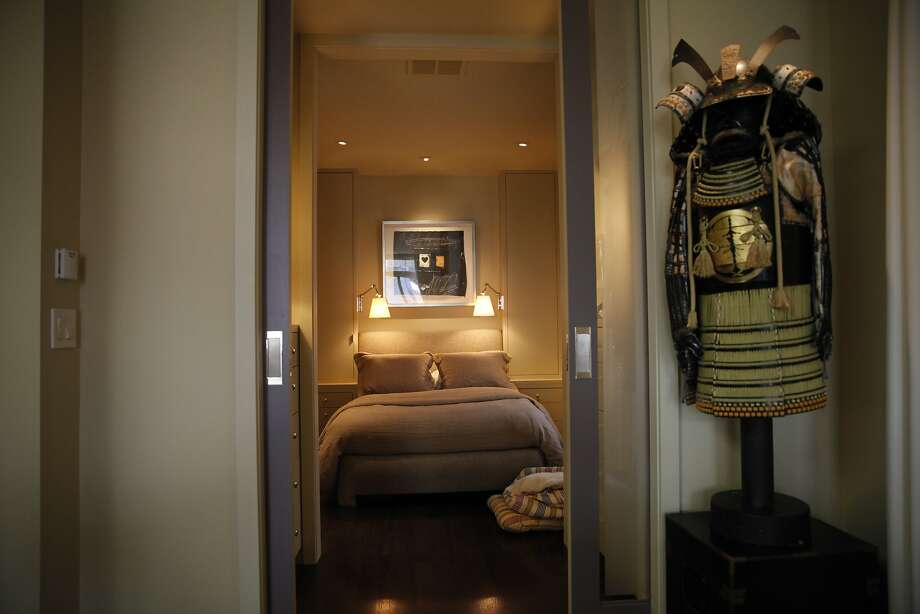 Samurai armor decorates the exterior of the bedroom  in the home of Christopher Cara in San Francisco. Photo: Lea Suzuki, The Chronicle