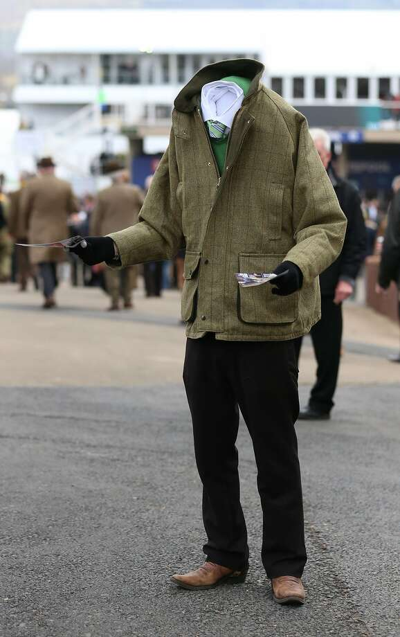 Headless horse man:A greeter hands out leaflets on the first day of the Cheltenham Festival in Cheltenham, England. Thousands of jump racing enthusiasts are expected for the four-day festival, which started Tuesday. Photo: Matt Cardy, Getty Images