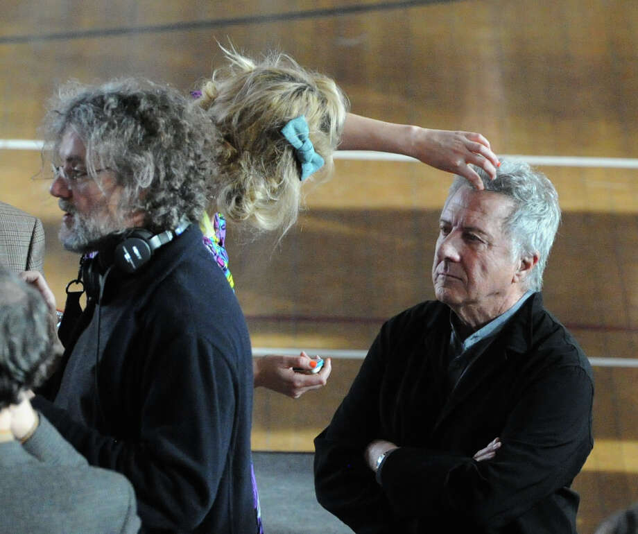 "Actor Dustin Hoffman, right, gets makeup applied to his face on the set of ""Boychoir,"" that was filming at the Greenwich Civic Center in Old Greenwich, Conn.,Tuesday afternoon, March 11, 2014. At left is the film's Director, Francois Girard. Photo: Bob Luckey / Greenwich Time"