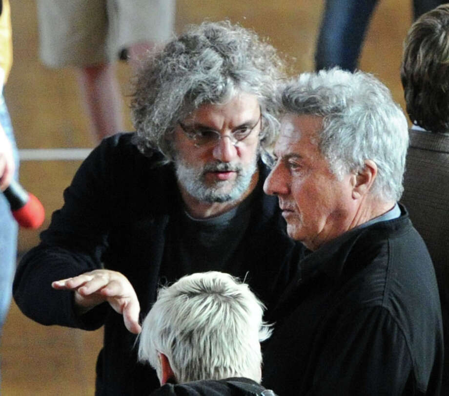 "Actor Dustin Hoffman, right, gets instruction from Director, Francois Girard, on the set of ""Boychoir,"" that was filming at the Greenwich Civic Center in Old Greenwich, Conn.,Tuesday afternoon, March 11, 2014. Photo: Bob Luckey / Greenwich Time"