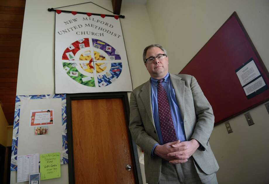 The Rev. Paul Fleck poses inside the New Milford United Methodist Church in New Milford, Conn. on Tuesday, March 11, 2014.  The Rev. Fleck was assistant counsel to the Rev. Dr. Thomas Ogletree, former dean of Yale University and Drew University Theological Seminary, who was brought up on charges that he violated church law by marrying his gay son and partner two years ago.  On Monday, the case was settled with the ruling that no clergy will be brought to trial over same sex marriages. Photo: Tyler Sizemore / The News-Times