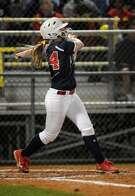 Atascocita's Shelby McGlaun drives a ball against Klein Collins during their game at AHS.