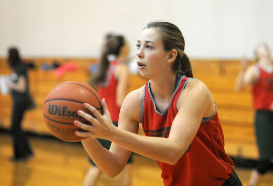 TWHS senior Nicole Iademarco works on her shot during a Lady Highlander practice. Photo: Jerry Baker, Freelance