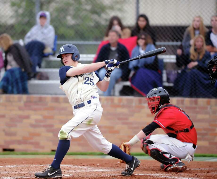 St. Johns defeated Second Baptist in the Father Wilson/Sister Julia baseball tournament,6-4,  3-7-14. Left, Second Baptist batter Jake Bedevian (25) takes a big swing in his first at bat. Photo: Eddy Matchette, Freelance / Freelance