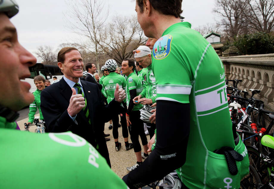Sen. Richard Blumenthal, D-Conn., gives two thumbs up to Team 26, a group of cyclists who rode from Newtown, Conn., to Washington, in honor of victims of gun violence and urging Congress to act to prevent gun violence, Tuesday, March 11, 2014, on Capitol Hill in Washington. The cyclists include parents of children who attend or attended Sandy Hook Elementary School, Omar Samaha who lost his sister Reema at the Virginia Tech shooting, and professional and top amateur cyclists from the U.S. National Team and Junior World Championships National Team. Photo: AP Photo/Jacquelyn Martin, AP / Associated Press