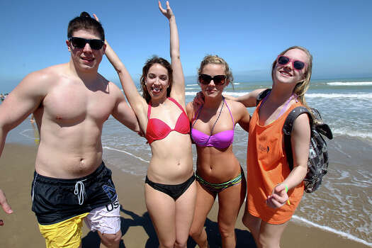 Creighton College buddies Jared Willey (from left) , Alyssa Povy, Ashley Jackson and Jenny Fleege make their way down the waterfront during Spring Break 2014 on the South Padre Island beach near Clayton's  on March 11, 2014. Photo: Tom Reel, Express-News
