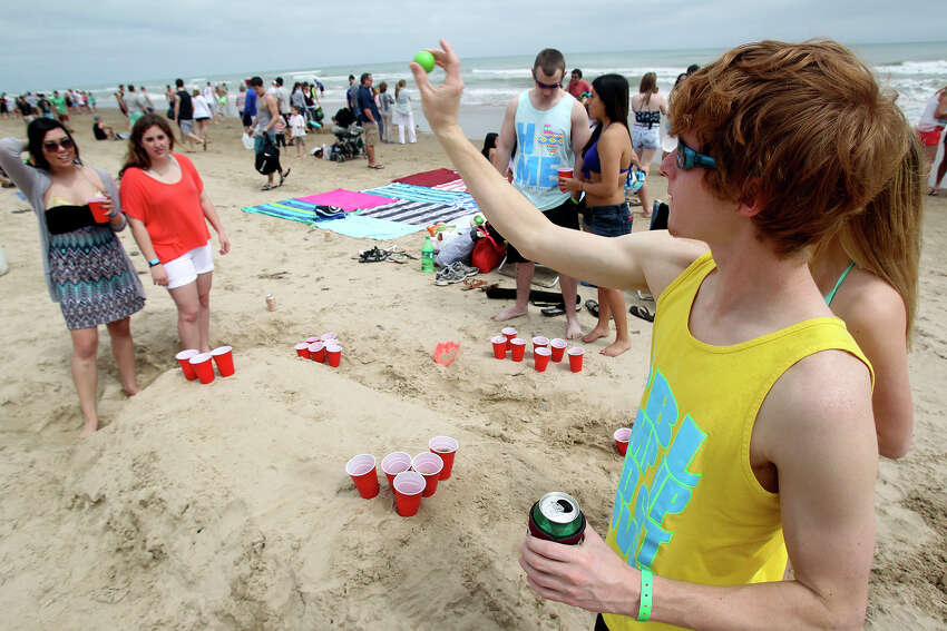 Chase Kaiser, an Aggie, plays some beer pong during Spring Break 2014 on the South Padre Island beach near Clayton's on March 11, 2014.