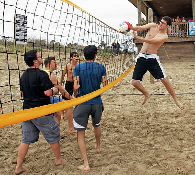 Pick up volleyball games gather some attention during Spring Break 2014 on the South Padre Island beach near Clayton's  on March 11, 2014. Photo: Tom Reel, Express-News
