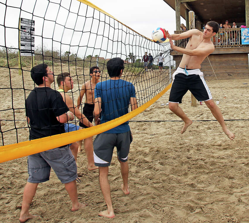Pick up volleyball games gather some attention during Spring Break 2014 on the South Padre Island beach near Clayton's on March 11, 2014.