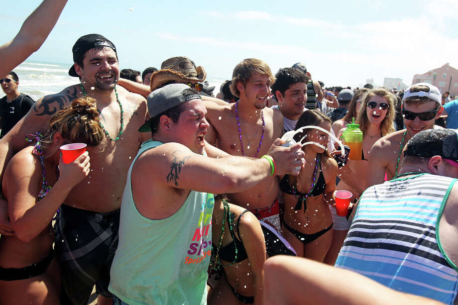 Suds start to fly in a party group during Spring Break 2014 on the South Padre Island beach near Clayton's  on March 11, 2014. Photo: Tom Reel, Express-News