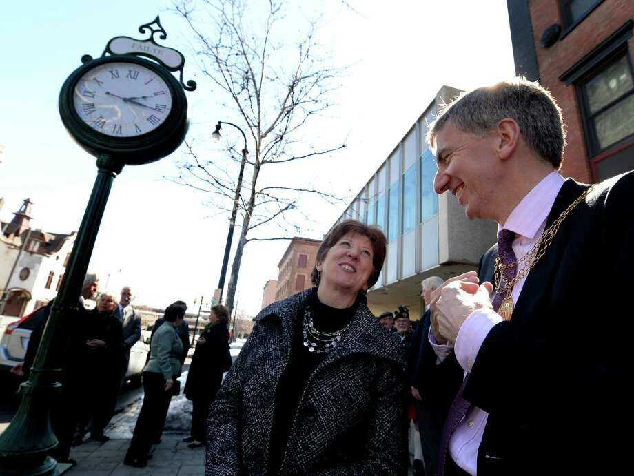 Albany Mayor Kathy Sheehan, left, enjoys a happy moment with the Lord Mayor of Belfast Martin Muilleor, right, at the dedication of a clock outside the Irish Heritage Museum Tuesday afternoon, March 11, 2014, in Albany, N.Y.  (Skip Dickstein / Times Union) Photo: SKIP DICKSTEIN / 00026049A