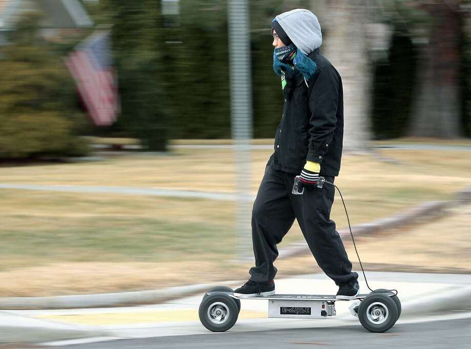 Saming Senket rides an electric skateboard in Washington. The boards can hit 18 mph. Photo: Bob Brawdy, Associated Press