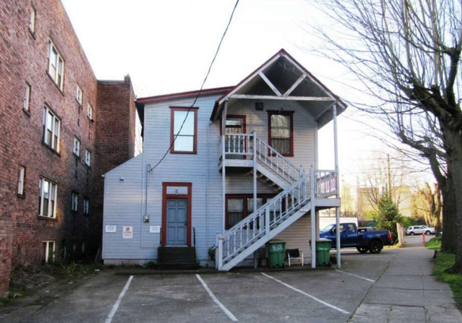 """1523 E. Madison Street – 1893-1898 – This former single-family residence, now home to offices, was built during one of Seattle's earliest building booms. At the time, the Central District was one of the city's first """"streetcar suburbs."""" was driven largely by a new streetcar line. Photo: Photos Provided To Seattle Historic Preservation Office"""