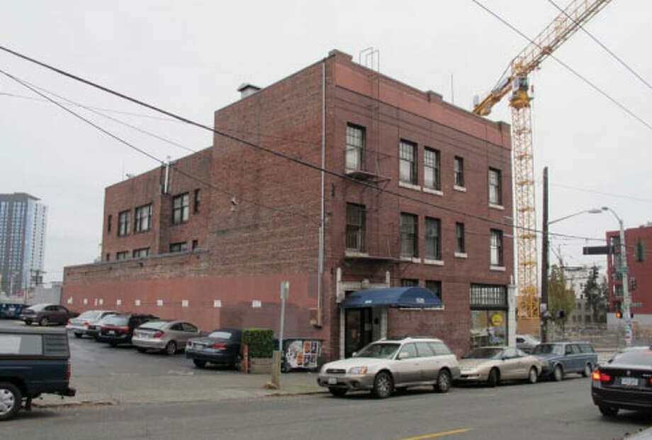 """Timken Roller Bearing Building – 1916-1917 – This Capitol Hill building was part of Seattle's """"auto row"""" shortly after it was built. Apartments above and storefronts below, the building catered to working singles interested in urban living. It's also known as the Pinevue Apartments. Photo: Photos Provided To Seattle Historic Preservation Office"""