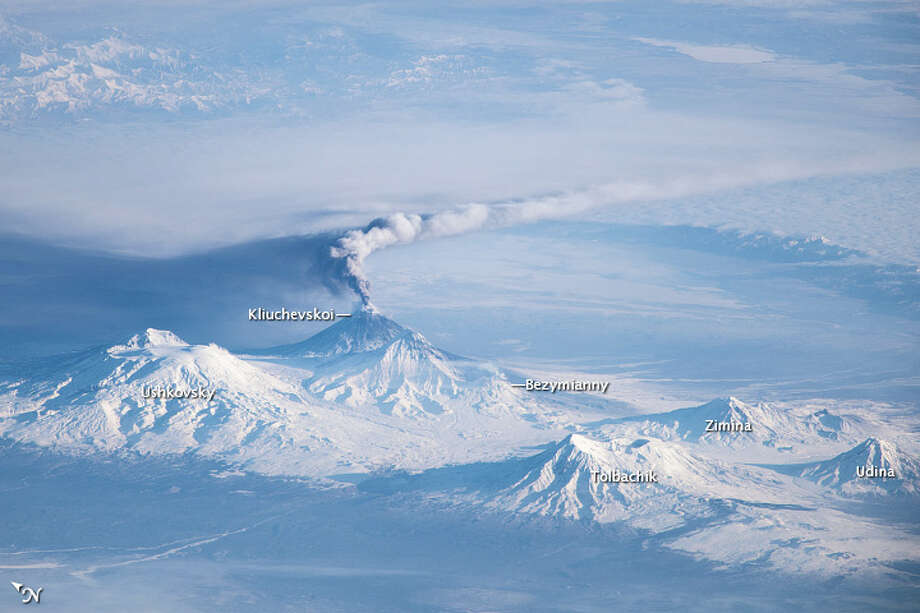 Category: Photograph Section. When viewing conditions are favorable, astronauts on the International Space Station (ISS) can take unusual and striking images of the Earth. This photograph provides a view of an eruption plume emanating from Kliuchevskoi, one of the many active volcanoes on the Kamchatka Peninsula.