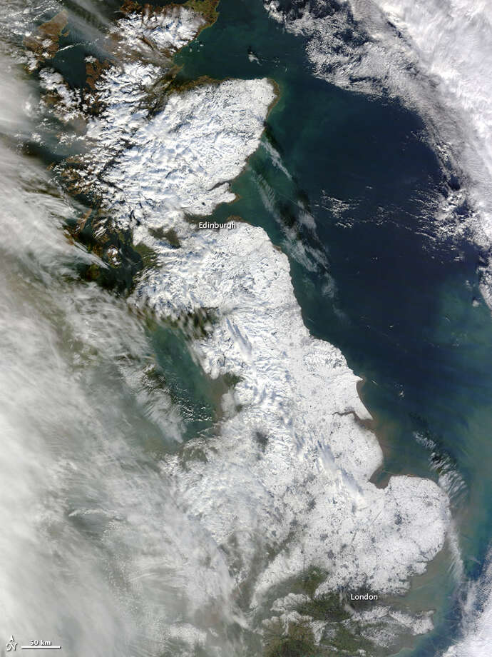 Category: Art Section.Snow blanketed most of Great Britain in late January 2013, stretching from London to the northern tip of Scotland. The Moderate Resolution Imaging Spectroradiometer (MODIS) on NASA's Terra satellite captured this natural-color image on January 26, 2013. Only some coastal areas and the southwestern part of the island were free of snow when MODIS took this picture. Skies had mostly cleared by the time MODIS acquired the image, but some clouds lingered in the west, casting shadows onto the snowy surface below.On January 25, The Telegraph reported that the death toll from the storm was in the double digits, some of the deaths resulting from hazardous driving conditions. As of that date, more snowfall was expected, including near-blizzard conditions in parts of Scotland. Forecasters called for rain to follow the snow, with as much as 40 millimeters (1.6 inches) of rain in western Britain.