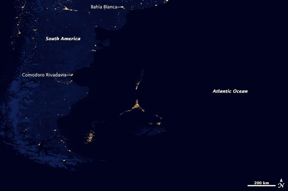 "Category: Events Section.In December 2012, NOAA and NASA released a new map of the Earth at night. Built with data from the Visible Infrared Imaging Radiometer Suite (VIIRS) on the Suomi NPP satellite, this revision to the iconic ""night lights"" map offered better clarity and resolution than ever before, and much more sensitivity to light.Among the surprises turned up by the new map, VIIRS found something fishy off the coast of Argentina. About 300 to 500 kilometers (200 to 300 miles) offshore, a city of light appeared in the middle of the South Atlantic Ocean (image above). There are no human settlements there, nor fires or gas wells. But there are an awful lot of fishing boats. Adorned with lights for night fishing, the boats cluster along invisible borders: the edge of the continental shelf, the nutrient-rich Malvinas Current, and the boundaries of the exclusive economic zones of Argentina and the Falkland Islands. The night fishermen are hunting for Illex argentinus, a species of short-finned squid that forms the second largest squid fishery on the planet."