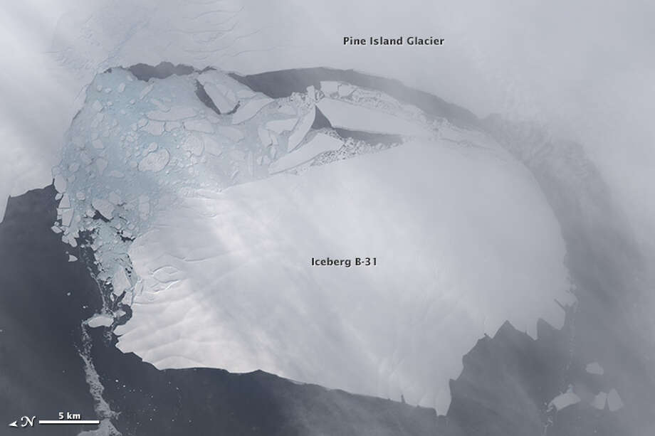 Category: Events Section.Between November 9–11, 2013, a large iceberg finally separated from the calving front of Antarctica's Pine Island Glacier. Scientists first detected a rift in the glacier in October 2011 during flights for NASA's Operation IceBridge. By July 2013, infrared and radar images indicated that the crack had cut completely across the ice shelf to the southwestern edge. New images now show that Iceberg B-31 is finally moving away from the coast, with open water between the iceberg and the edge of Pine Island Glacier.