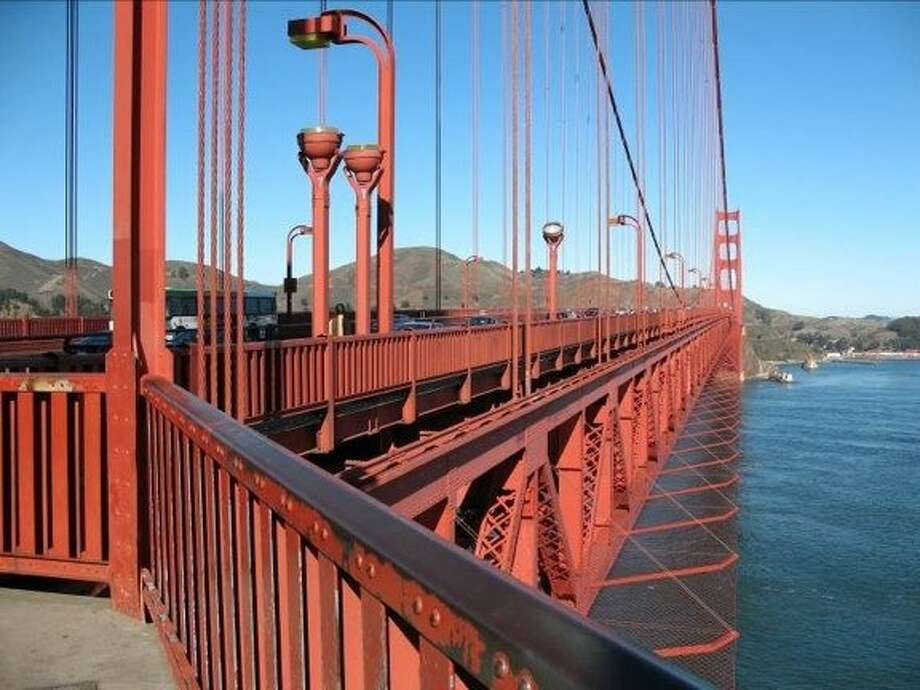 Designs of a Golden Gate Bridge suicide barrier include replacement rails and nets that extend out from the sides of the span. Photo: GG Bridge Highway/Transportation, Courtesy