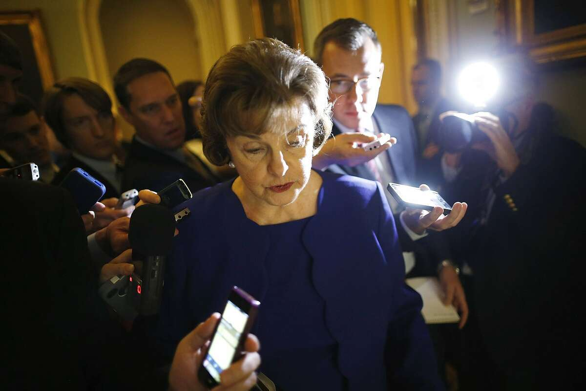 U.S. Senator Dianne Feinstein (D-CA) is trailed by reporters as she walks to the weekly Democratic caucus policy luncheon at the U.S. Capitol in Washington March 11, 2014. A dispute between the Central Intelligence Agency and a U.S. Senate committee that oversees it burst into the open on Tuesday when Feinstein accused the agency of spying on Congress and possibly breaking the law. REUTERS/Jonathan Ernst (UNITED STATES - Tags: CRIME LAW POLITICS TPX IMAGES OF THE DAY)