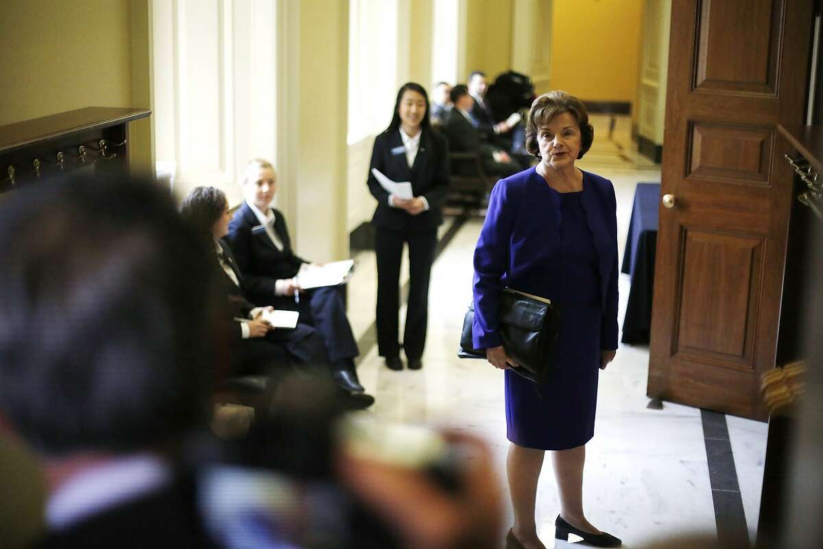 U.S. Senator Dianne Feinstein (D-CA) turns to talk to reporters as she walks to the weekly Democratic caucus policy luncheon at the U.S. Capitol in Washington March 11, 2014. A dispute between the Central Intelligence Agency and a U.S. Senate committee that oversees it burst into the open on Tuesday when Feinstein accused the agency of spying on Congress and possibly breaking the law. REUTERS/Jonathan Ernst (UNITED STATES - Tags: POLITICS CRIME LAW)
