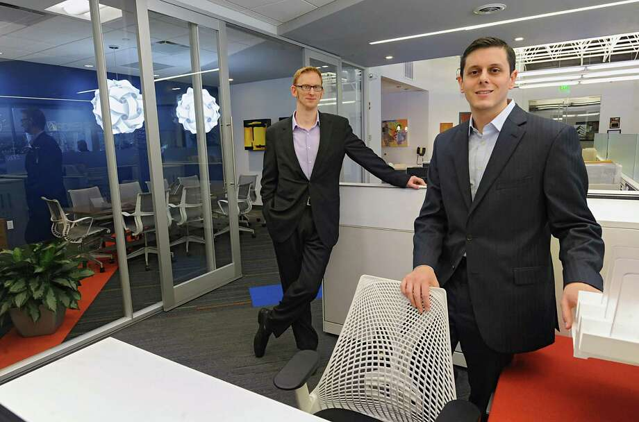 "Executive Vice President Jeffrey Mirel, left, and CEO Seth Rosenblum stand in the new ""innovation lab"" of office space designed for the technology market at Rosenblum Companies on Tuesday, March 11, 2014 in Albany, N.Y.  (Lori Van Buren / Times Union) Photo: Lori Van Buren / 00026085A"