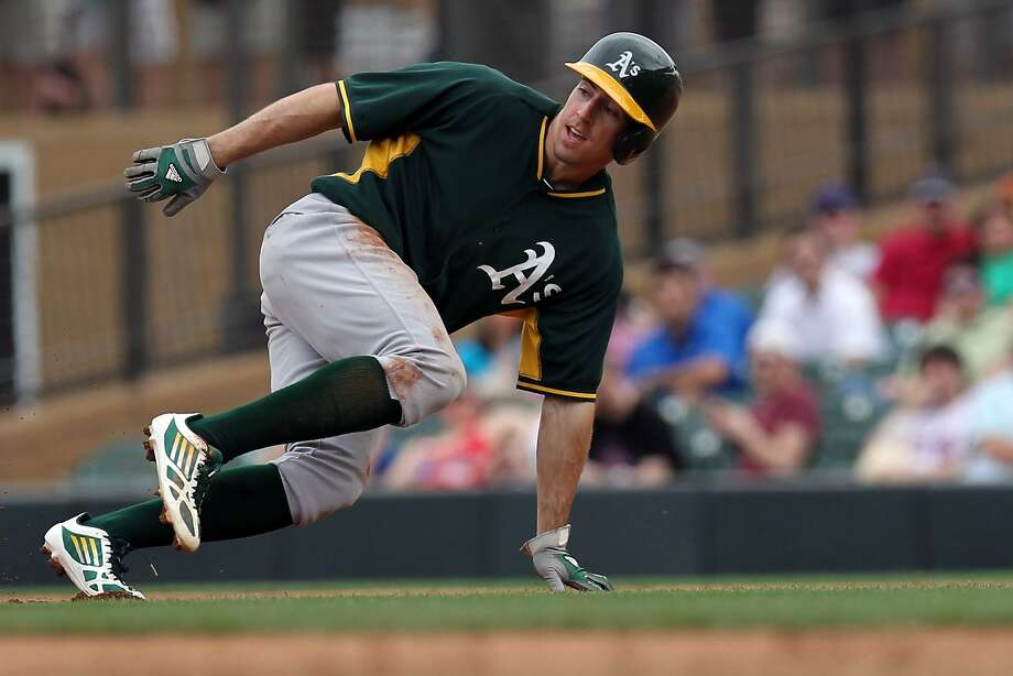 Minor-league outfielder Billy Burns sprints back toward first last week in an exhibition game against Arizona. Photo: Lance Iversen, Reuters