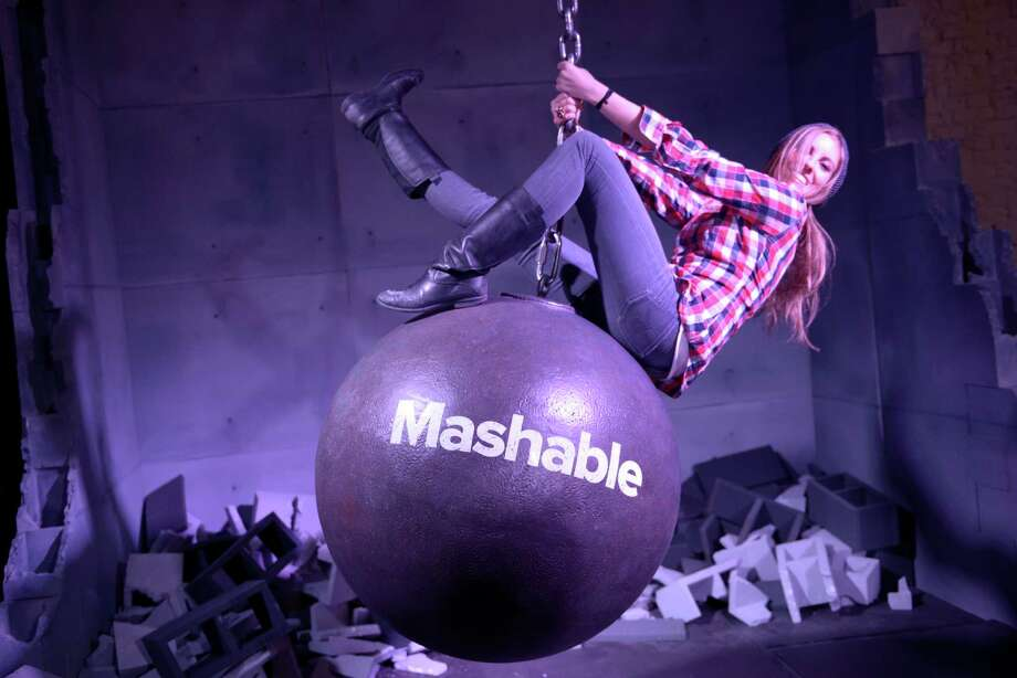 A girl plays on a fake wrecking ball at the Mashable House. Photo: Stephen Mclaren, Stephen McLaren For San Francisco Chronicle / ONLINE_YES