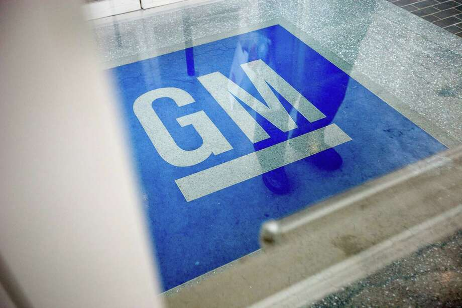 In this Thursday, Jan. 10, 2013 file photo, the logo for General Motors decorates the entrance at the site of a GM information technology center in Roswell, Ga. The Justice Department is investigating whether General Motors broke any laws with its slow response to a deadly problem with ignition switches on certain small cars, according to an AP source. (AP Photo/David Goldman, File) Photo: David Goldman, Associated Press / Associated Press contributed