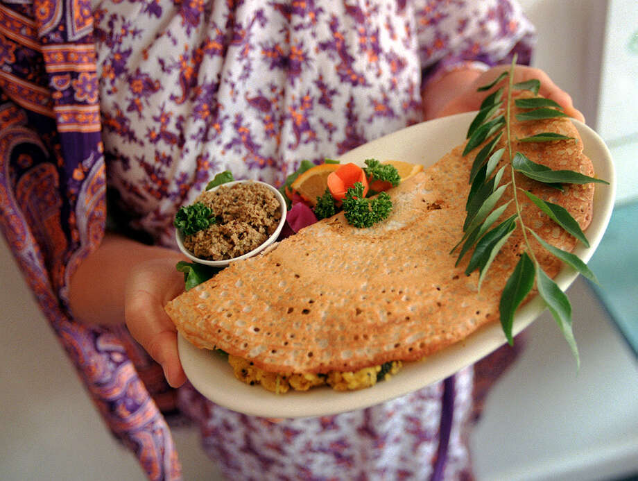 The masala dosa is a crispy, flat crepe, made from rie and lentil flour and filled with potatoes, onions and coriander. Silence-Heart-Nest Restaurant in the University District Photo: RICK GIASE, Seattlepi.com File Photo