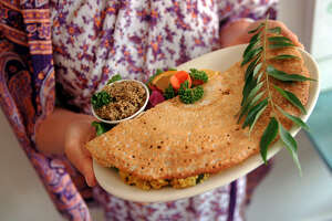 The masala dosa is a crispy, flat crepe, made from rie and lentil flour and filled with potatoes, onions and coriander. Silence-Heart-Nest Restaurant in the University District