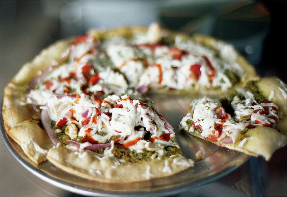 Pizza Pi, 5500 University Way NE, Seattle, WA 98105. If any of you vegans thought you had to give up pizza and calzones, take heart. Get your standard pizza toppings or change it up with Indian curry, cheesesteak or Thai chicken. Gluten-free crust available, too. Photo: Flickr/Richie Preiss