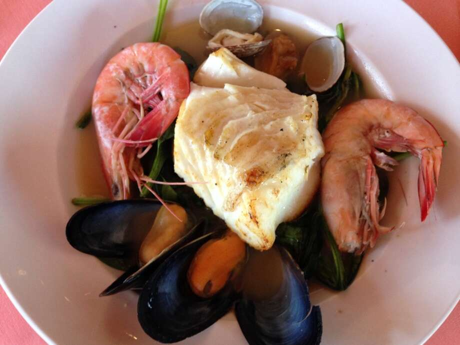 Chilean sea bass in a seafood broth with mussels, clams and Gulf shrimp. (Photo: Greg Morago)