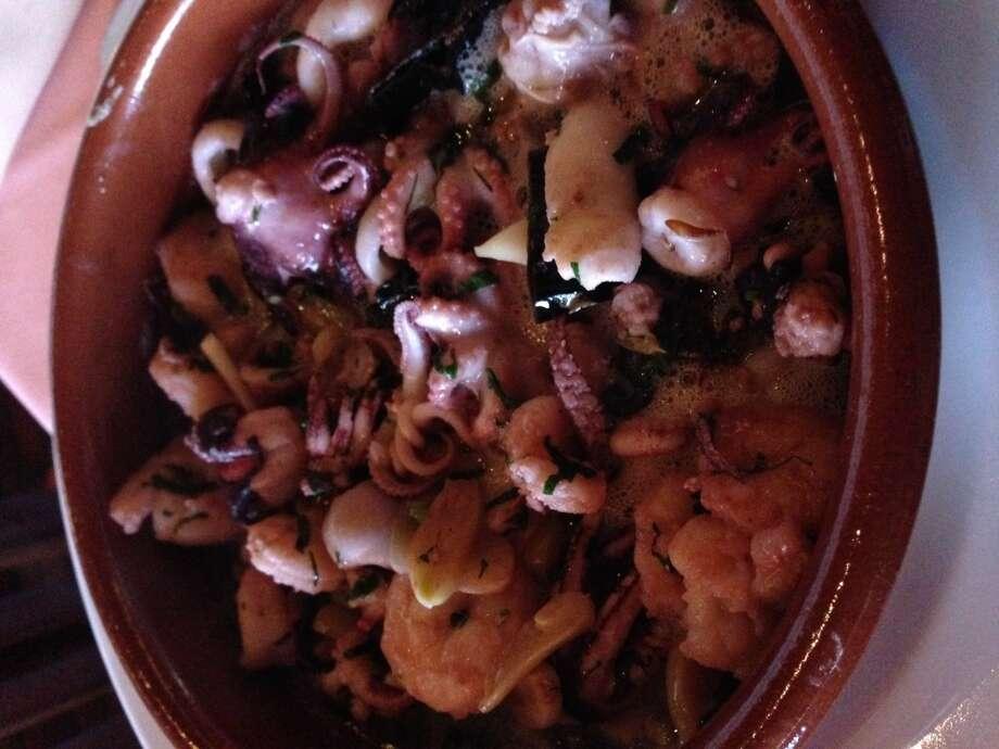 . Mariscada al ajillo: Squid, octopus and shrimp in a garlic-infused olive oil. (Photo: Greg Morago)