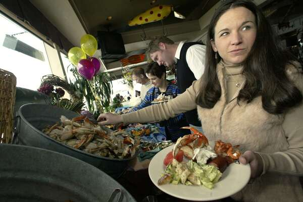 04/06/03 sundaybrunchxx fea Julie Vanacker loads up on cracked Dungeness crab during All-you-care-to-eat buffet at Salty's on Alki Beach. Jim Bryant/P.I. Photo