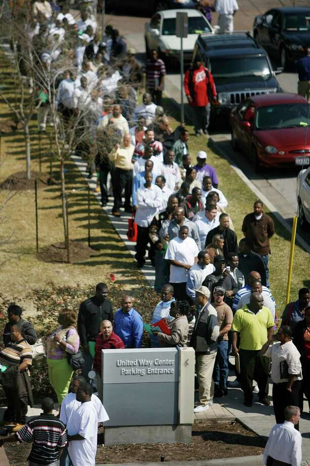 Hundreds of convicted felons stand in line in hopes to get a job at the United Way of Greater Houston on March 3, 2010 in Houston, TX.   Photo by Mayra Beltran / Houston Chronicle Photo: Mayra Beltran, Staff / Houston Chronicle