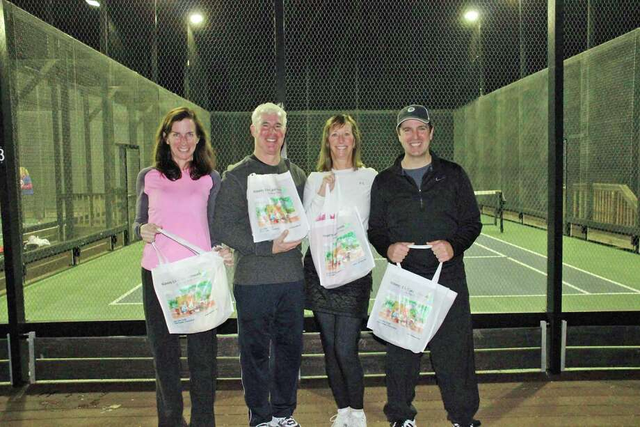 Waveny Mixed Paddle tournament Country Club flight winners Sharon Stevenson and Chris Chiaia (right) with runners up Cindy and Ron Holland Kelly (left). Photo: Contributed Photo, Contributed / New Canaan News Contributed